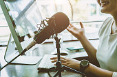 istock People working at home for making internet radio broadcasting channel live streaming talking meeting or discussion closeup condenser microphone. 1254170843