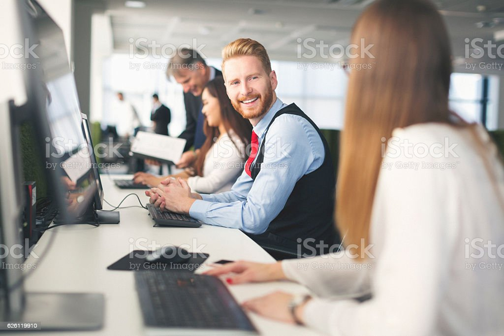 People working at it center and talking stock photo