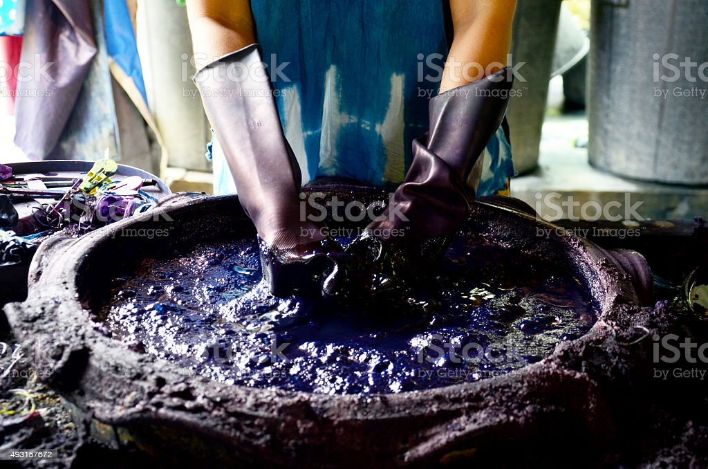 People working Batik dye Mauhom color stock photo