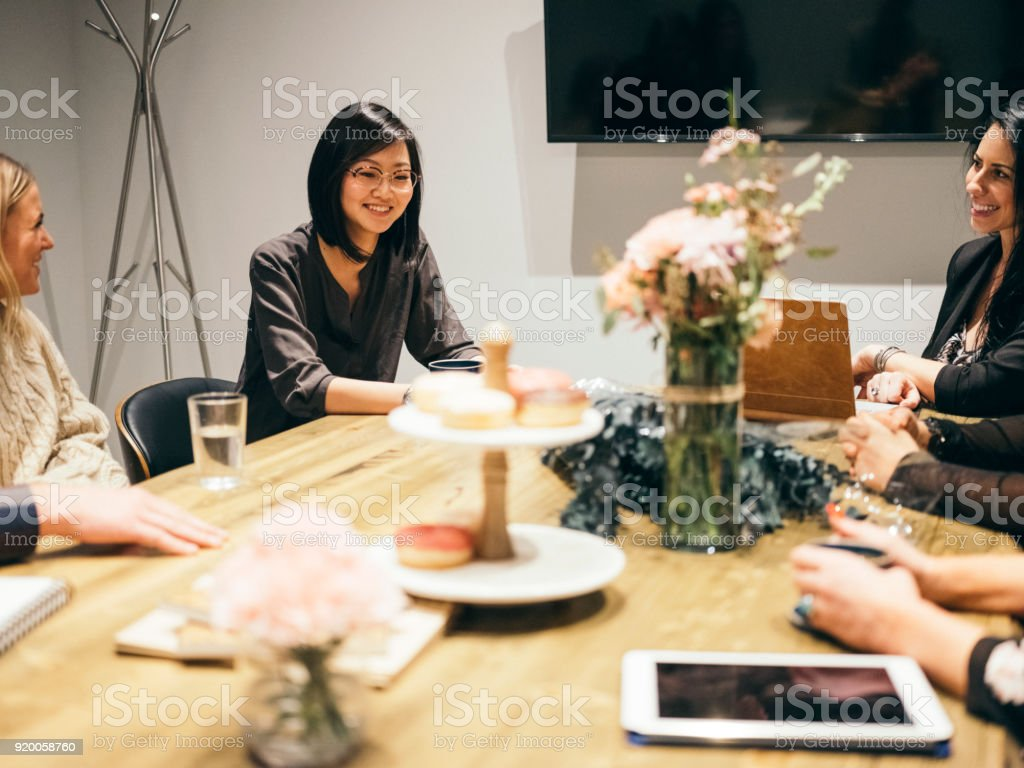 People Working in a Cafe Coffee Shop Meeting Space stock photo