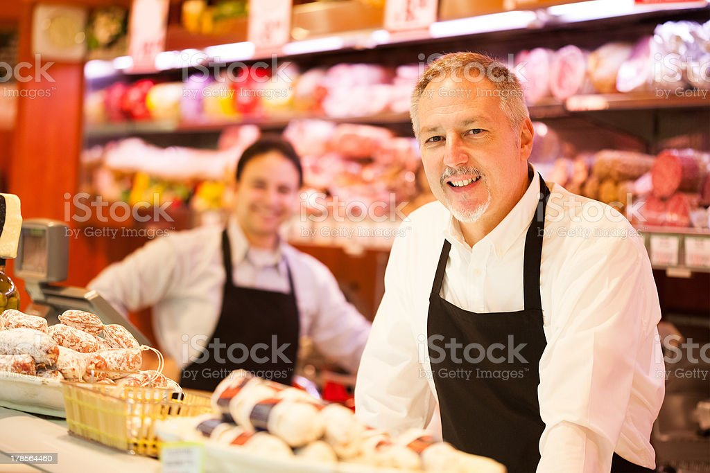 People working in a grocery store stock photo