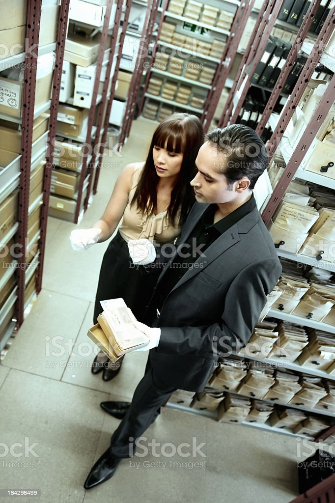 People working in a library royalty-free stock photo