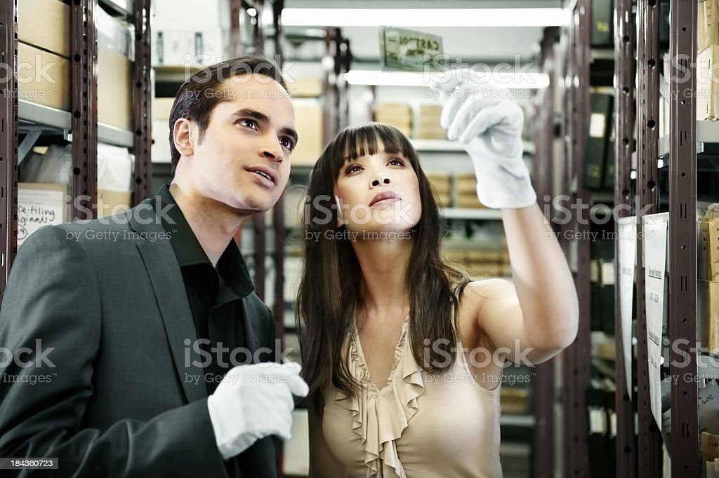 People working in a library stock photo