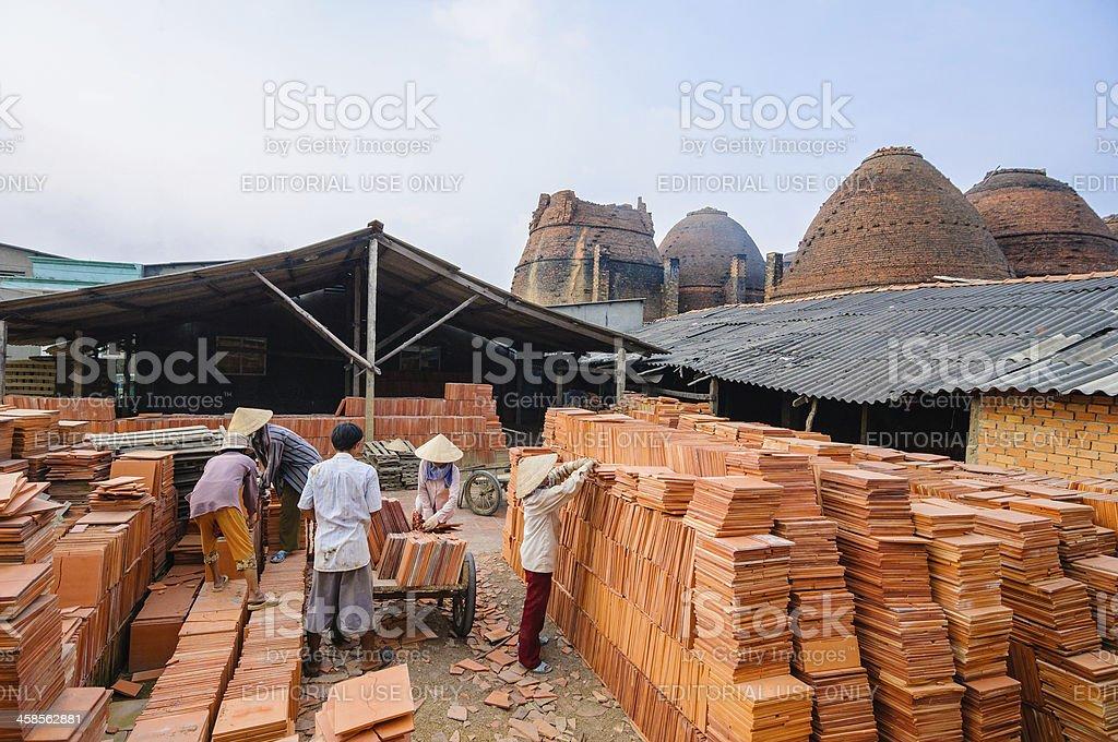 People working in brick kiln factory, Mekong Delta, Vietnam stock photo