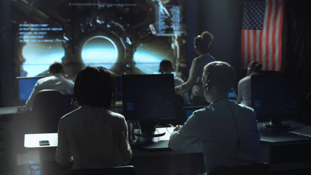 People working in mission control center - foto stock