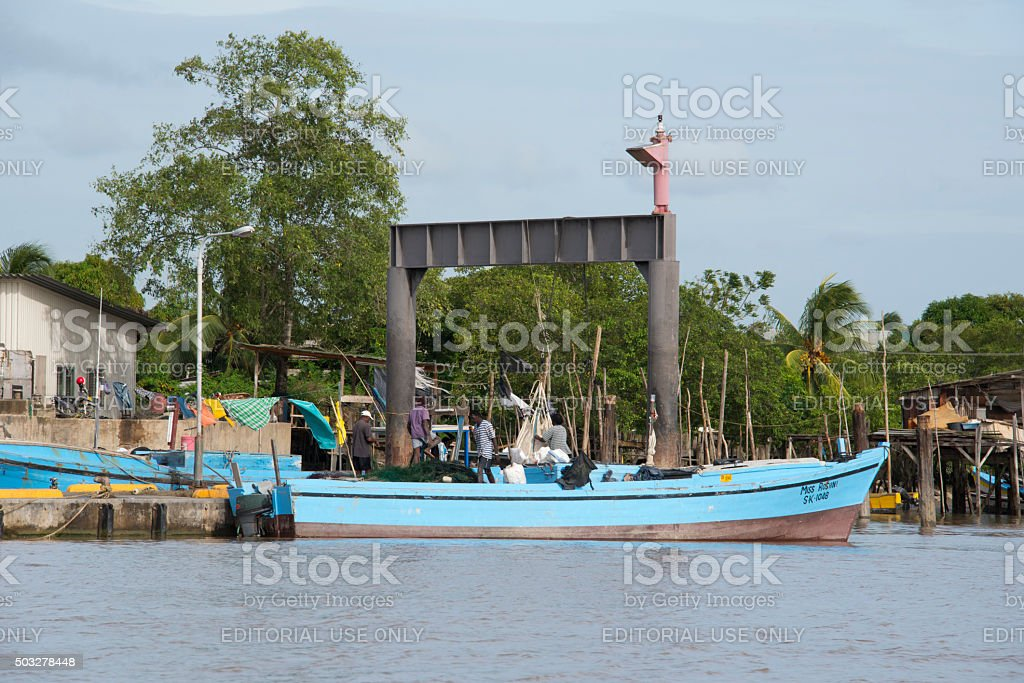 People working on a fishing  boat stock photo