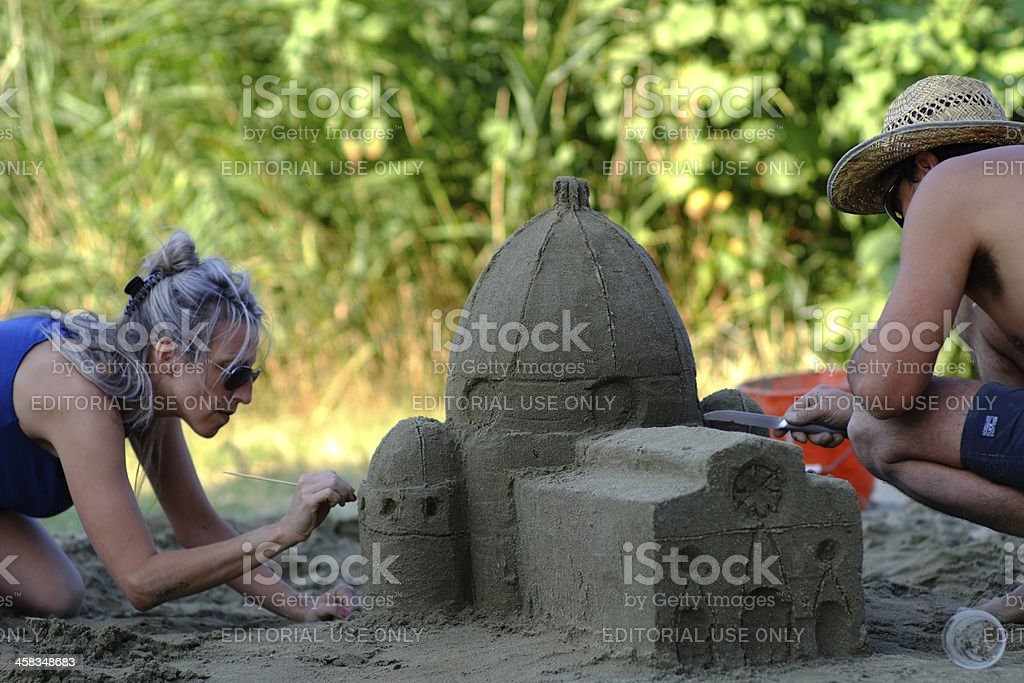 People working on a sand church royalty-free stock photo