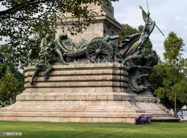 People working on Monumento aos Heróis da Guerra Peninsular, the monument erected in 190 -1951 on the square Rotunda in Porto, Portugal