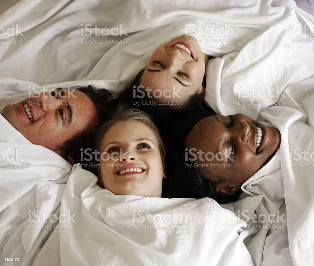 People wrapped in sheet on bed royaltyfri bildbanksbilder