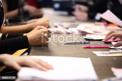 istock People write application form and submit document for Job interview 698545792