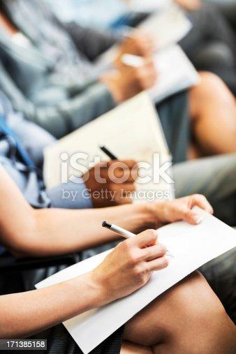 istock People writing on a seminar. 171385158