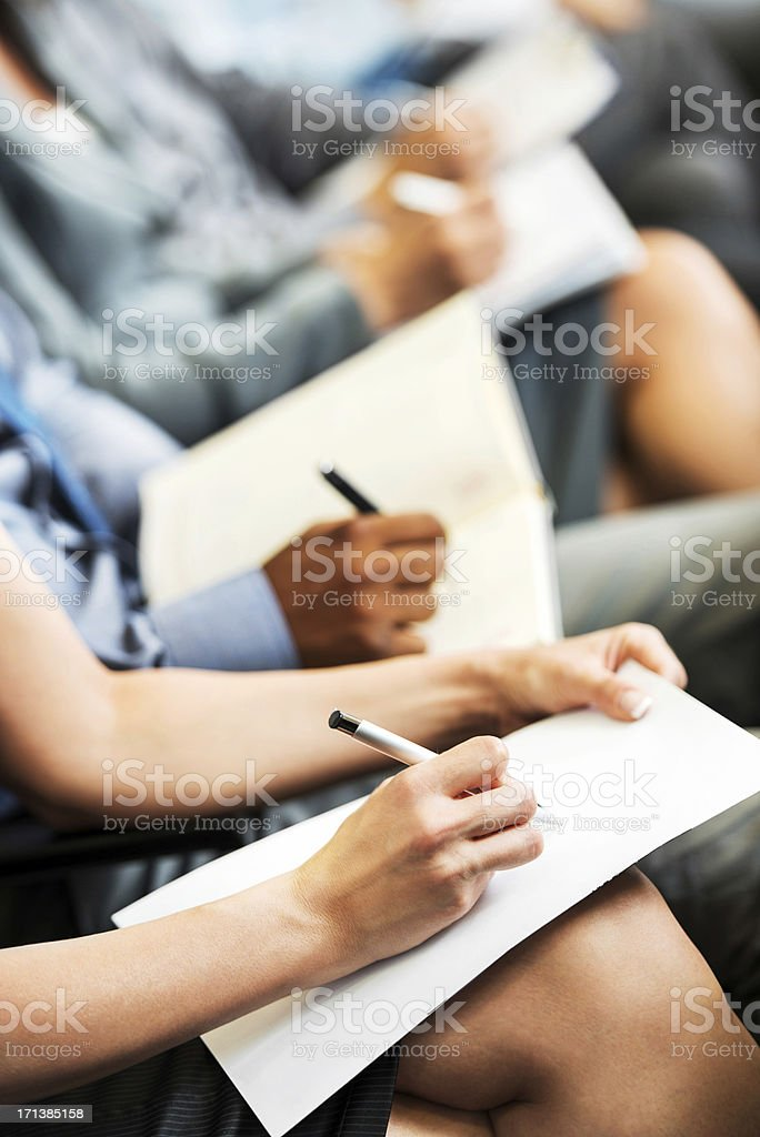 People writing on a seminar. stock photo
