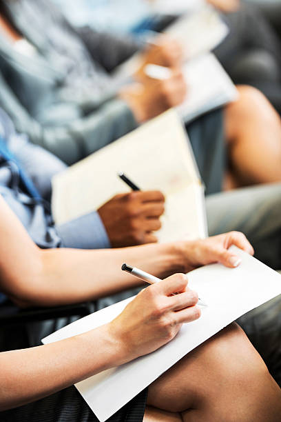 people writing on a seminar. - business writing stock pictures, royalty-free photos & images