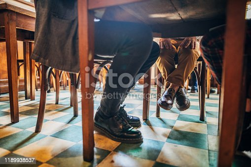 People's feet under the table in cafe