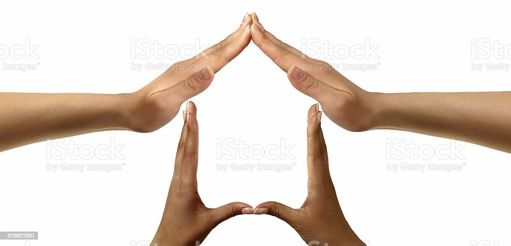 Peoples hands forming a home symbol royalty-free stock photo