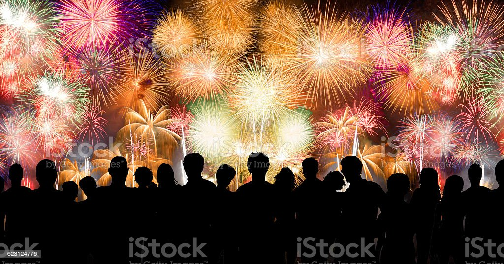 Peoples in silhouette enjoy watching amazing firework show stock photo