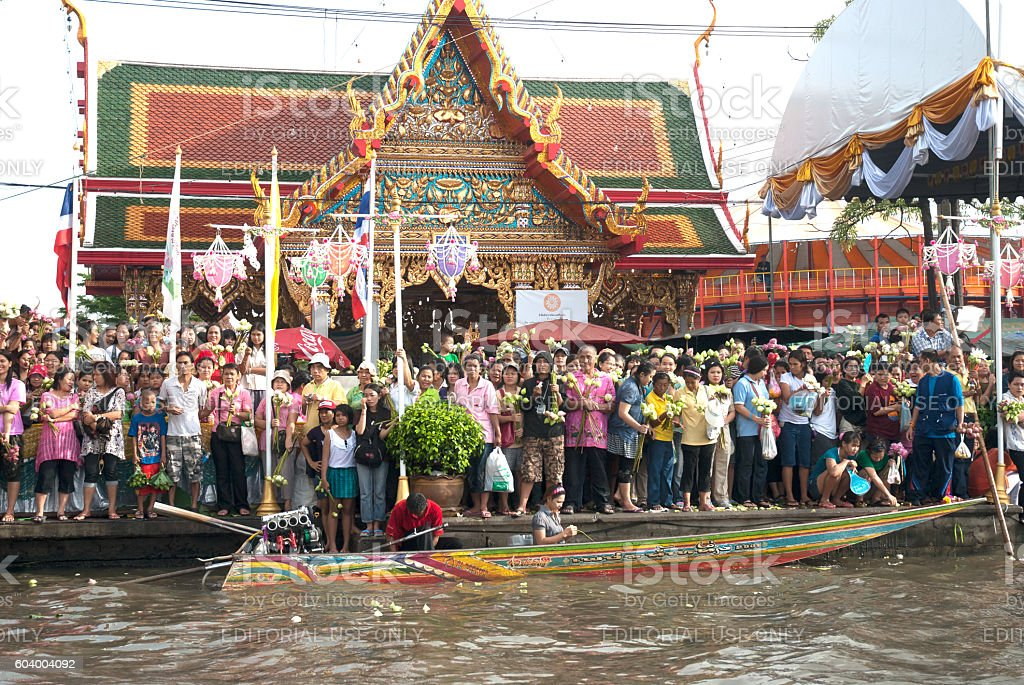 Peoples wait is throwing lotus on Rub Bua Festival,Thailand. stock photo