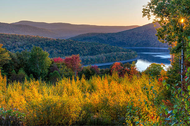Pepacton Reservoir Autumn Twilight Colorful Autumn sunset on the Pepacton Reservoir seen from the Shaverton Trail in Andes in the Catskills Mountains of New York. catskill mountains stock pictures, royalty-free photos & images