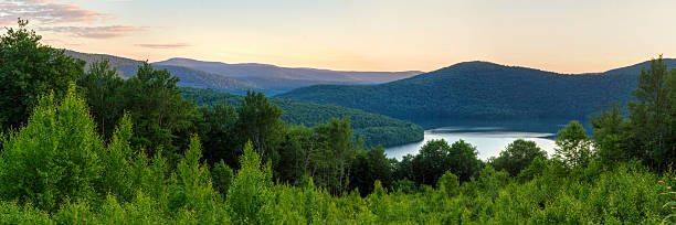 Pepacton Reservoir Overlook Panorama Panoramic view of the Pepacton Reservoir and Catskills Mountains at sunset from the Shaverton Trail overlook  in Andes, New York. catskill mountains stock pictures, royalty-free photos & images