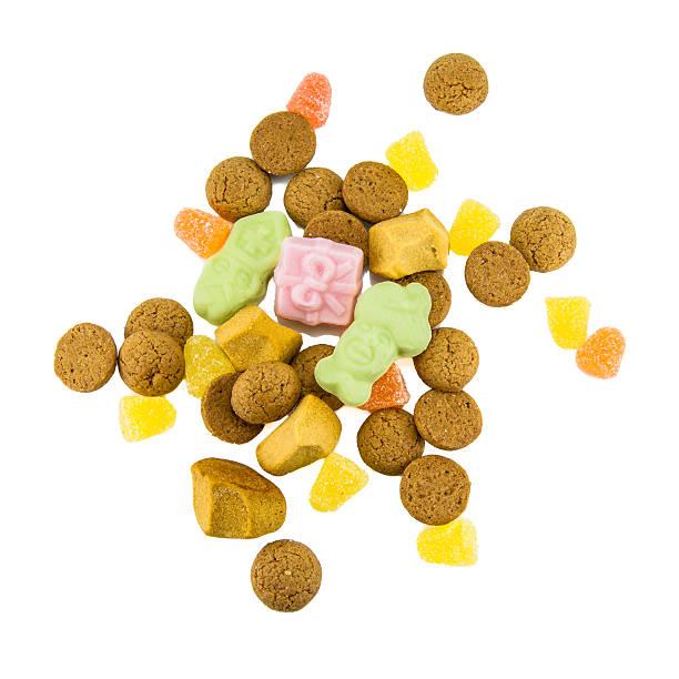 pepernoten and sweets isolated on white - kruidnoten stockfoto's en -beelden