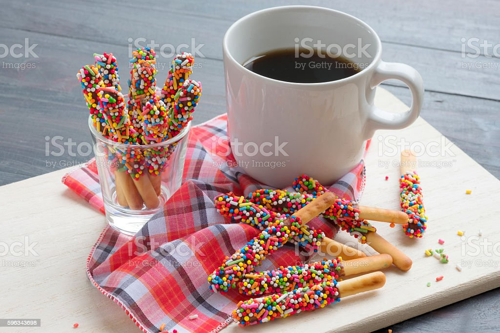 Pepero candy with hot coffee on wooden background. royalty-free stock photo