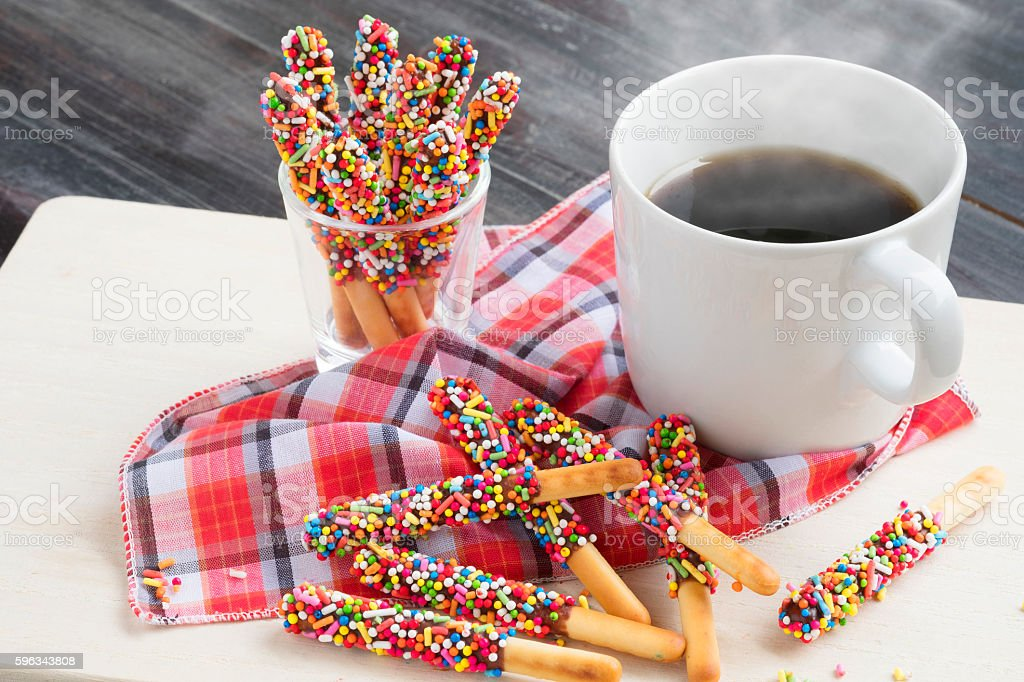Pepero candy with hot coffee on wooden background. Lizenzfreies stock-foto