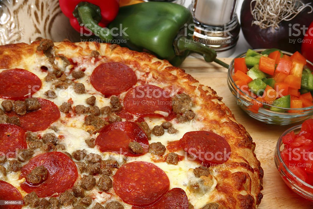 Peperoni and Sausage Pizza royalty-free stock photo