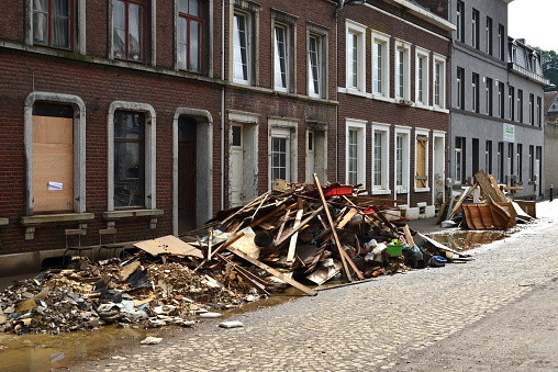 Pepinster, Liège, Belgium- August,01, 2021: 2 weeks after flood still damage visible in the streets. Collapsed Houses . messy heap on footpath in front of facades terraced houses. No passing, police announcement.