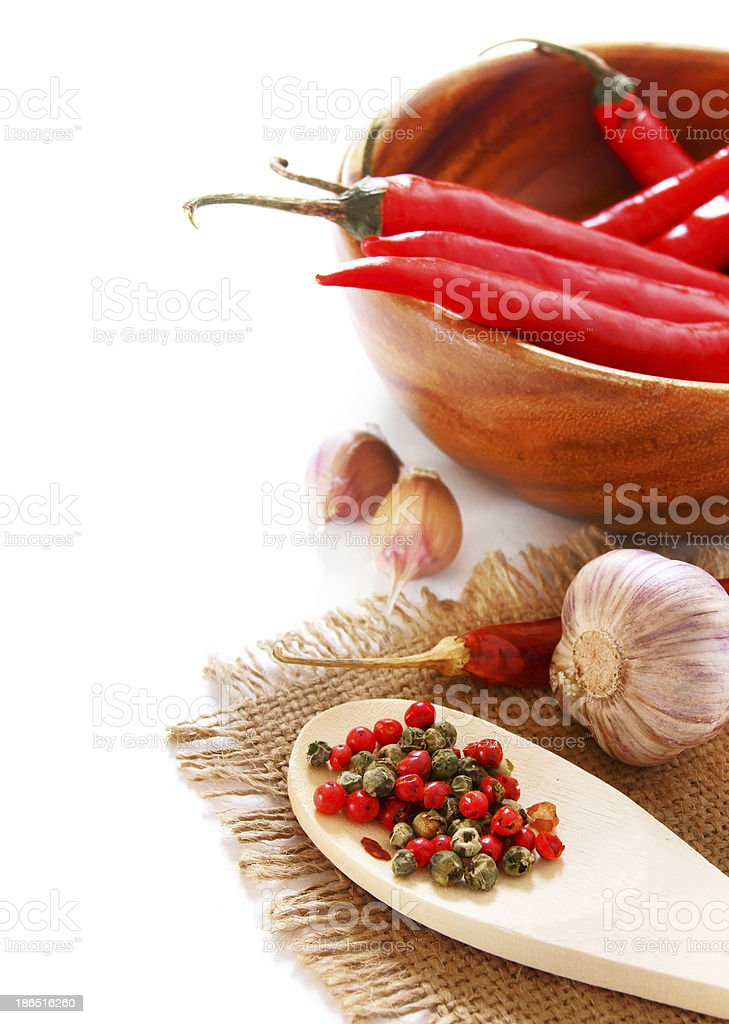 Pepper and garlic on an old fabric. royalty-free stock photo