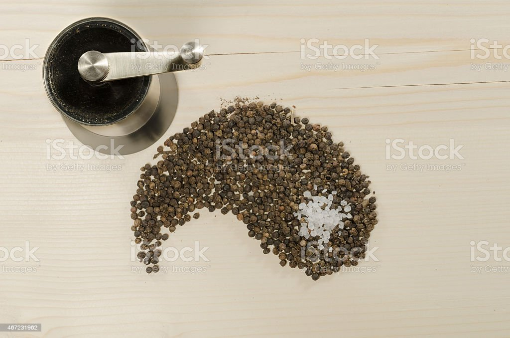 Pepper as yang on wooden background stock photo
