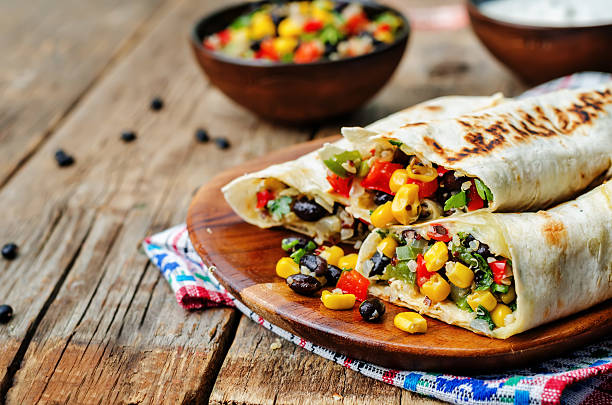 pepper corn black bean quinoa burritos - vegetarian stock photos and pictures