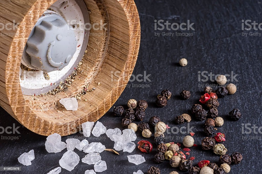 Pepper Grains, Sea Salt and Pepper Mill Background stock photo