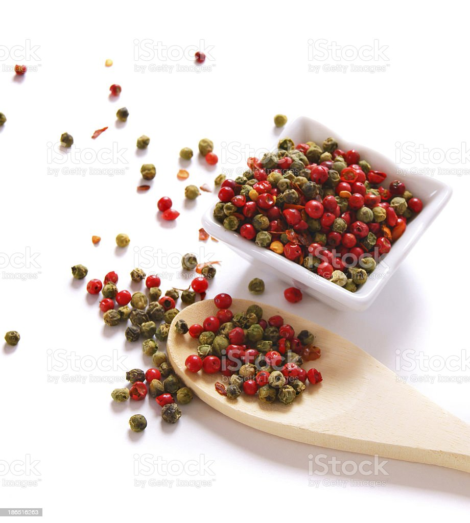 pepper on wooden spoon royalty-free stock photo