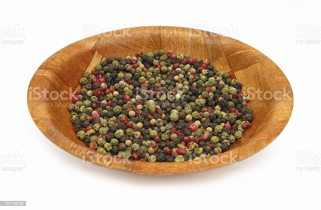 Pepper red, green and black in wooden dish isolated royalty-free stock photo
