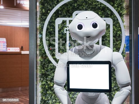 istock Kyoto, Japan - April 14, 2017 : Pepper Robot Assistant with Information screen Japanese Humanoid Technology at Kyoto station 982368866