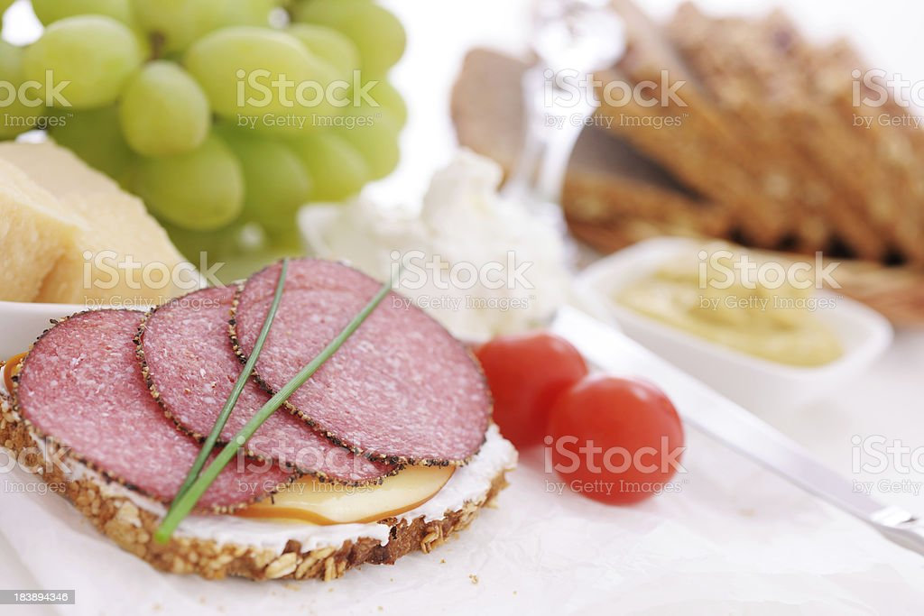 Pepper salami and smoked cheese sandwich royalty-free stock photo