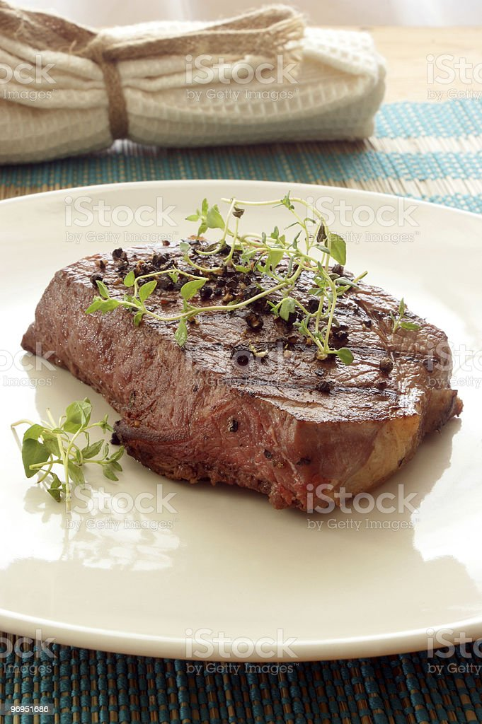 pepper steak with greek basil on a plate royalty-free stock photo