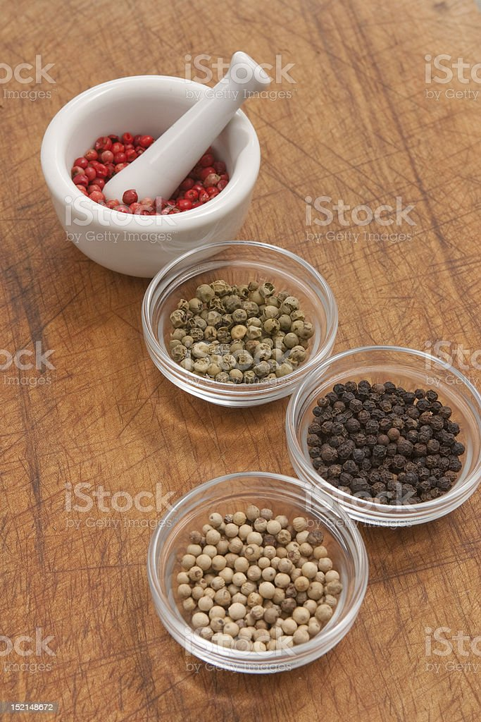 Pepper with mortar and pestle stock photo