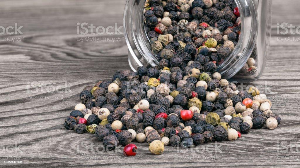 Peppercorn mix and spice jar. Piper nigrum. Great depth of field stock photo
