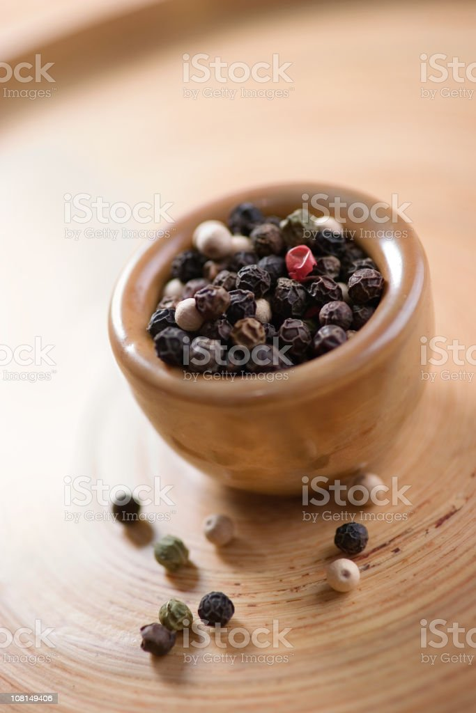 Peppercorns in small bowl royalty-free stock photo