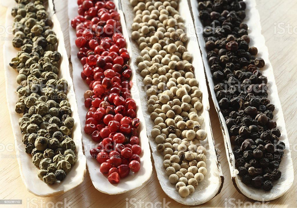 Peppercorns Spices in the sea shells on wood stock photo