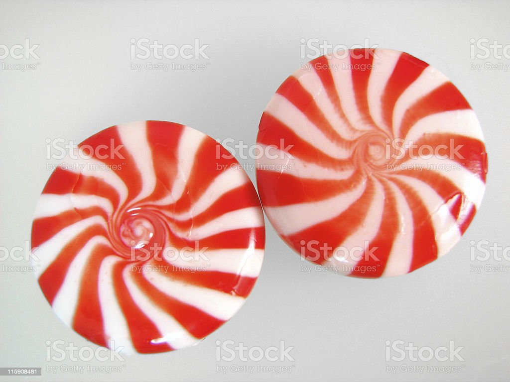 peppermint candies two red and white fancy peppermint candies Candy Stock Photo