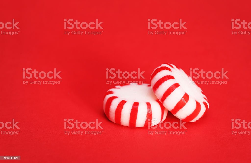 Peppermint Candy over Red Christmas background stock photo