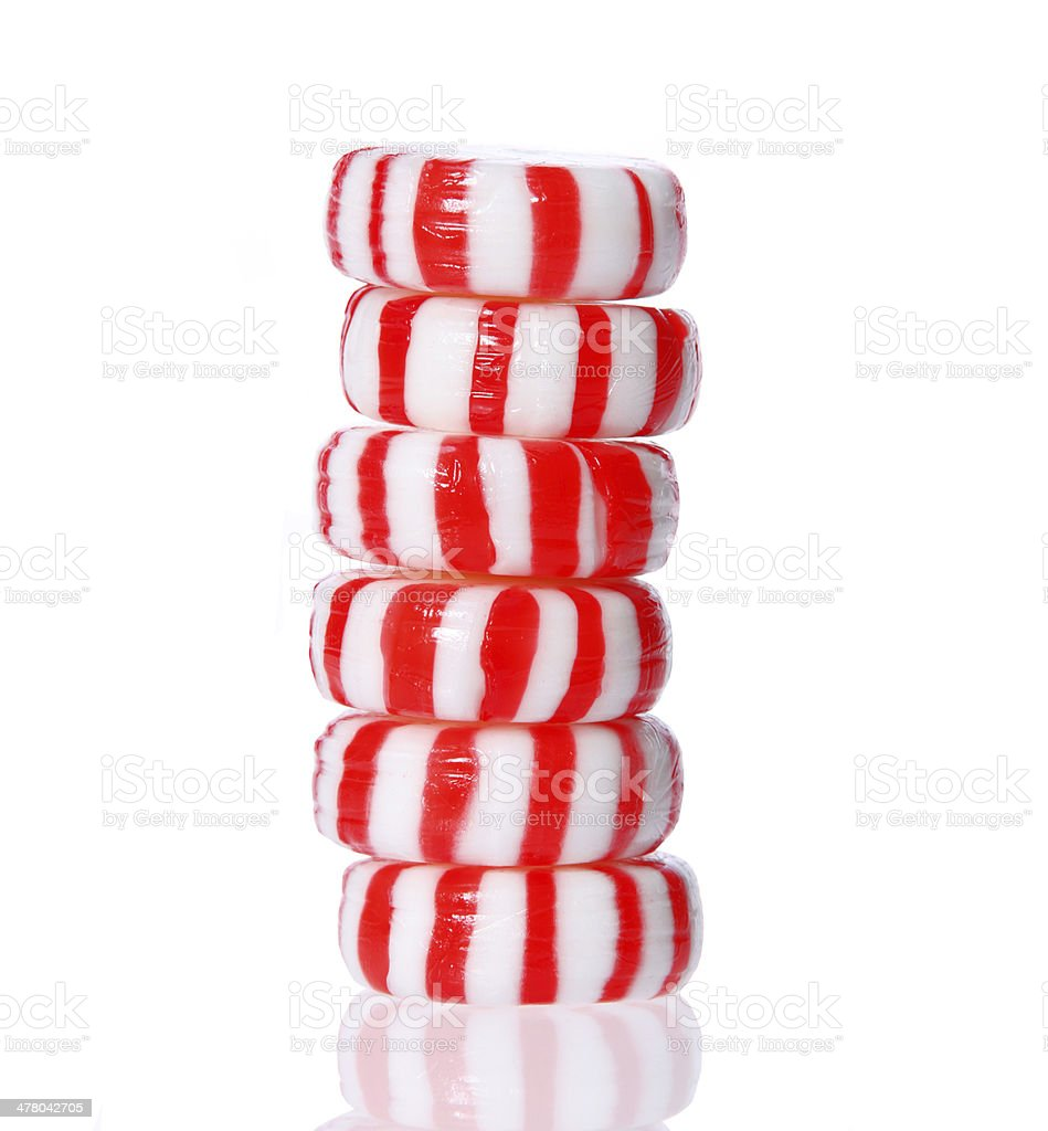 Peppermint candy tower isolated. Red and striped, macro. stock photo