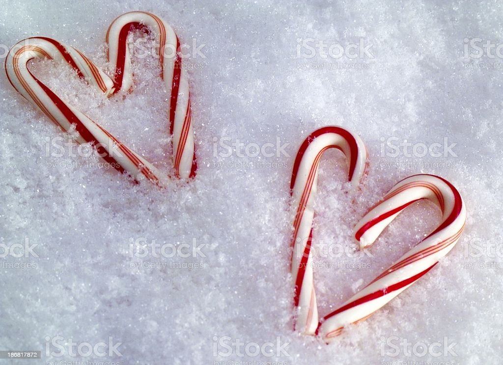 Peppermint sticks on a snowy background royalty-free stock photo