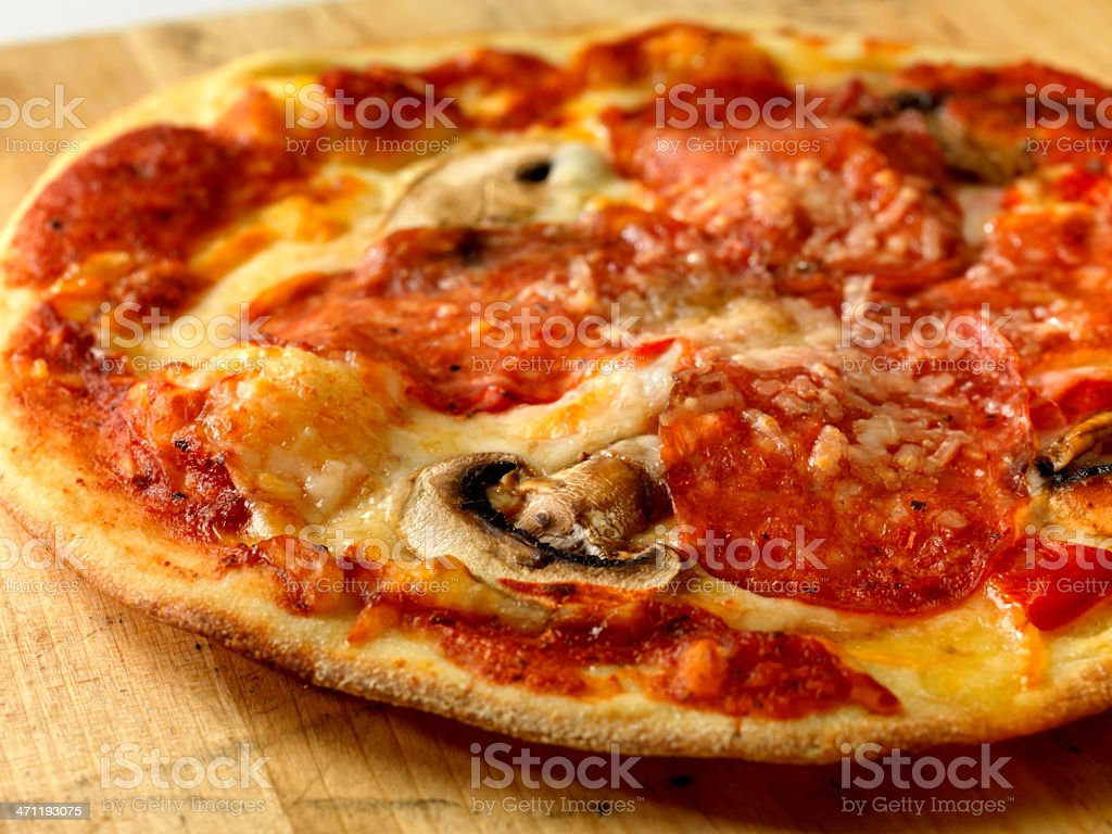 Pepperoni and Mushroom Pizza royalty-free stock photo