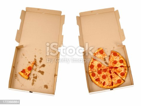 Picture of two pizzas in pizza boxes.
