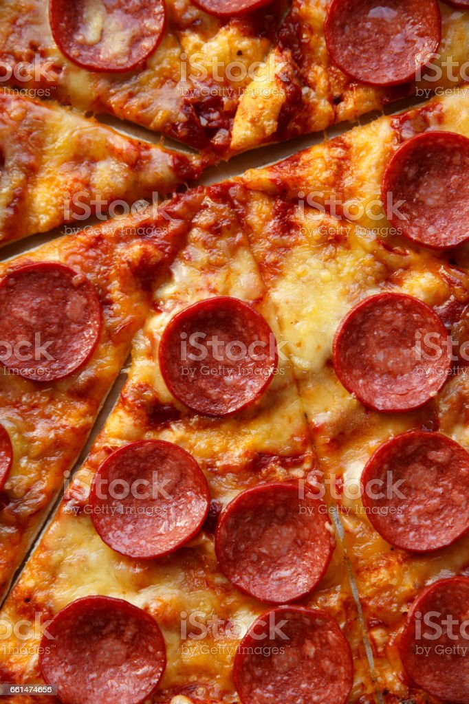 Pepperoni or salami pizza. Hot homemade food. stock photo