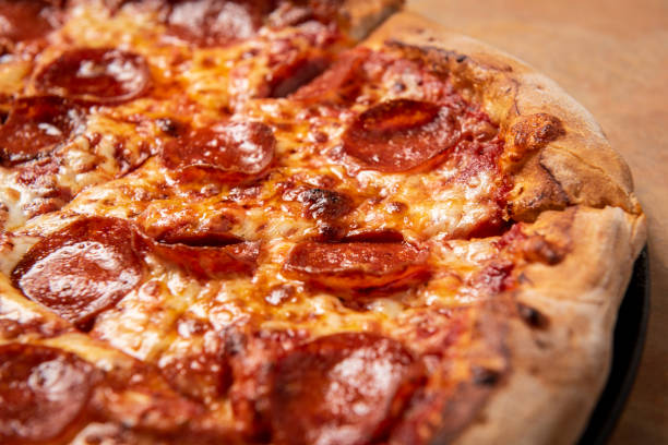 Pepperoni Pizza closeup Pizza restaurant food pizza stock pictures, royalty-free photos & images