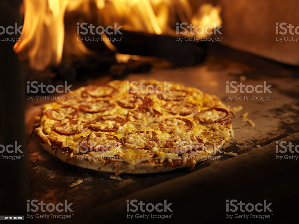 Pepperoni Pizza in a Wood Burning oven royalty-free stock photo